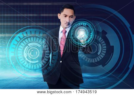 Young Asian Businessman Touching Digital Screen With Finger