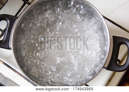 Pot full of boiling water on the stove