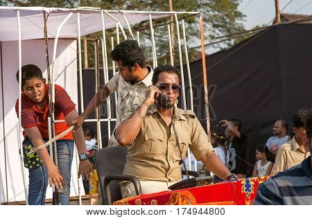 PANAJI, INDIA - FEB 25, 2017: Actors depict corrupt policemen and the iniquity during parade of the traditional Goa carnival on February 25, 2017. Carnaval is celebrated in Goa since 18th century