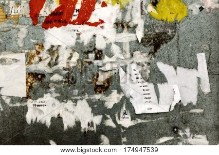 Urban Billboard With Torn Peeled Poster Horizontal Wide Grungy Background. Outdoor Bulletin Board Or
