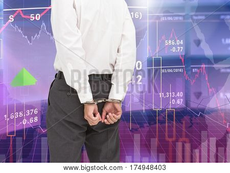 Digital composite image of businessman with hands bonded by hand cuffs against stock market graphics in the background