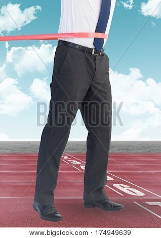 Digital composite image of businessman winning the race on the race track