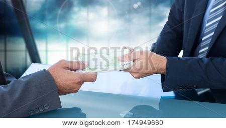 Conceptual image of businessman giving money to his colleague with corruption concept