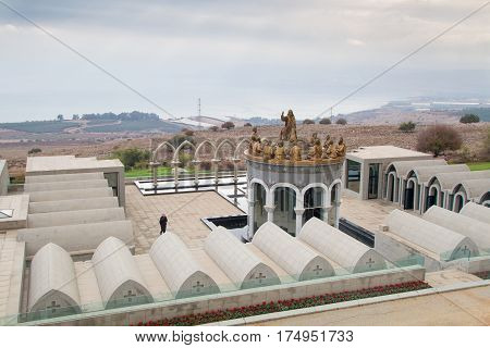 GALILEE ISRAEL - DECEMBER 3: The statues of Jesus and Twelve Apostles in Domus Galilaeae on the Mount of Beatitudes near the Sea of Galilee Israel on December 3 2016