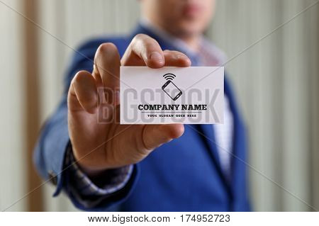 Businessman holding visit card. Man showing blank business card with phone icon. Person in blue suit. Mock up design.
