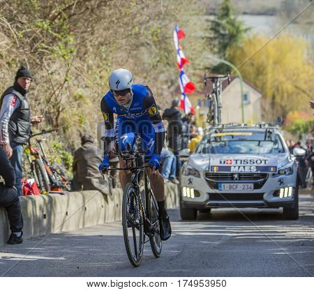 Conflans-Sainte-HonorineFrance-March 62016: The Belgian cyclist Nikolas Maes of Etixx-Quick Step Team riding during the prologue stage of Paris-Nice 2016.