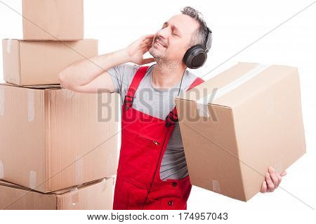 Mover Man With Headphones On Enjoying Music Holding Box