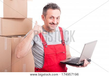 Mover Guy Holding Laptop Making Calling Gesture