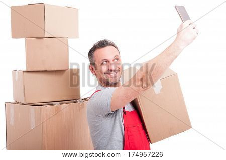 Mover Guy Holding Box Taking Selfie And Smiling