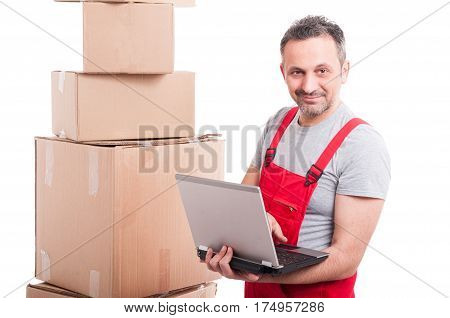 Mover Guy Holding Laptop With Cardboard Boxes Around