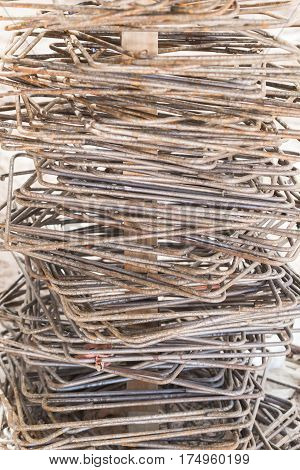 Old iron rods with rusted iron rods that are bent in square shape. For use in construction