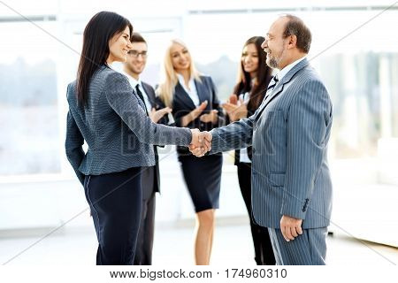business meeting business partners in office with a handshake