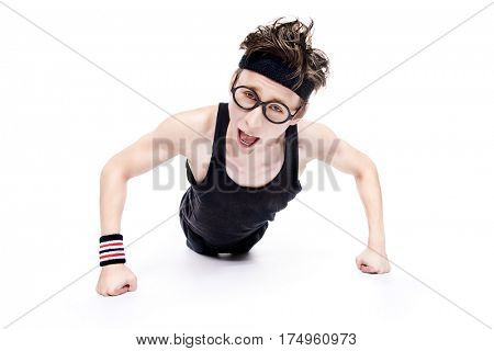 Funny thin man pushing from the floor. Bodybuilding, muscle building. Sports, activities concept. Isolated over white.