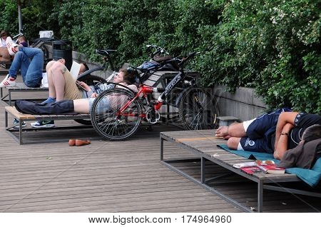 MOSCOW, RUSSIA - MAY 31, 2015: People rest on deckchairs in Gorky park in the summer