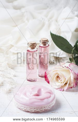 Cosmetic Cream With Pink Roses On A Wooden Table