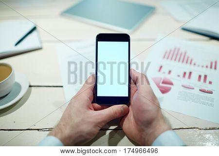 Smartphone in hands of banker or economist