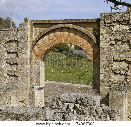 Scenic view ofcountryside through arch at Medina Azahara Cordoba