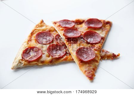 Pepperoni pizza. Hot homemade food. Slices of fresh italian classic salami pizza. Popular topping with cheese. Baked meal.