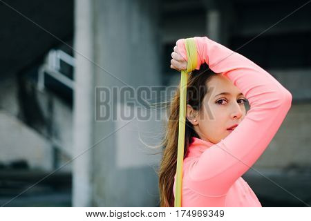 Woman Doing Triceps Extension Exercise With Resistance Band