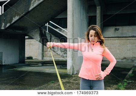 Woman Doing Shoulder Raises Exercise With Resistance Band