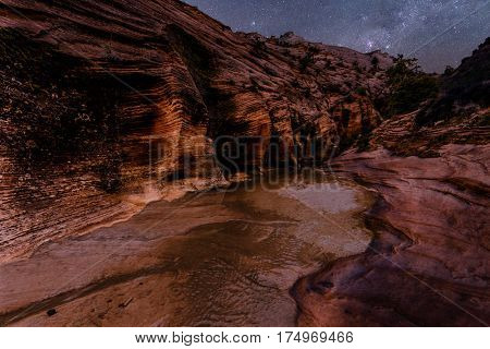 Stars shining over the mountains and river beneath them in Zion National Park. Utah, United States of America