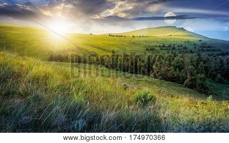 day and night time change. high mountain idyllic landscape. grassy meadow with forest on hillside. epic nature concept.