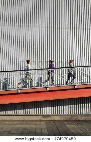 Group Of Women Running On A Ramp