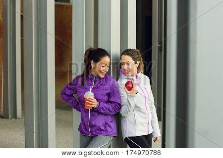 Two Women Enjoying Healthy Fitness Snack