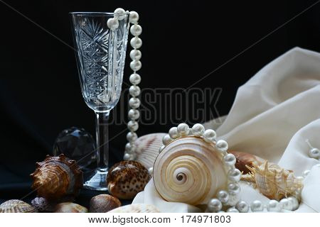 crystal glass , beads, pearls and seashells on the holiday table