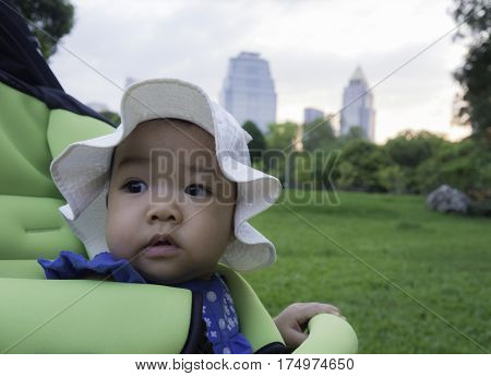8 months old cute asian girl baby seat in stroller