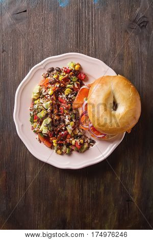 Fast Food. Bagel With Smoked Salmon And Capers. Gray Background.