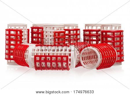 Red hair curlers, isolated on white background