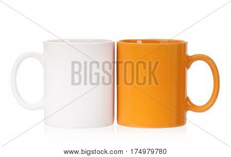 Orange and white mugs empty blank for coffee or tea isolated on white background