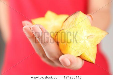 Woman holding starfruit