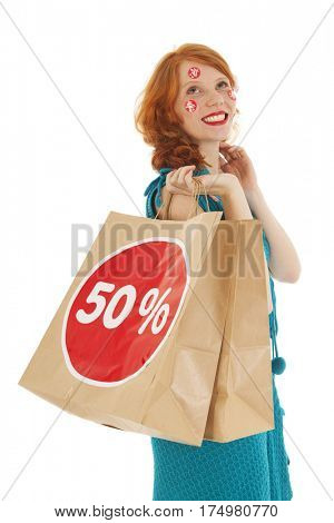 Woman with shopping bag and reduction
