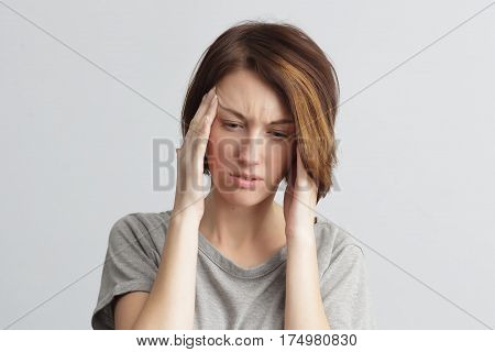 girl suffers from terrible headaches and compresses the head with fingers. Forget and remember something suffer from illness