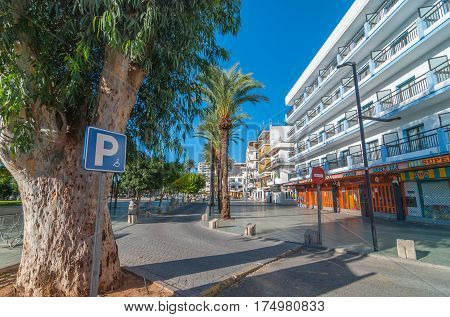 Sant Antoni de Portmany, Ibiza, November 6th, 2013.  Parking available for disabled & wheelchair bound people says the sign beside food shops in off-season Ibiza.