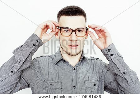 young handsome well-groomed guy posing emotional on white background, lifestyle people concept close up