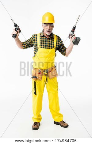 Full length portrait of mature workman holding electric drills