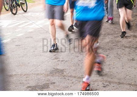 Blurry Running People In Marathon Speed Abstract