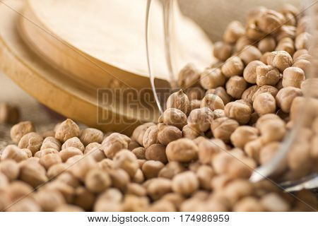 Pile of Dry Organic Uncooked Chickpeas. Healthy Raw Vegan Food Hummus With Chickpeas.