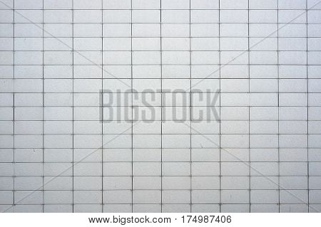 Wall coated with facing panels. Abstract architectural background.
