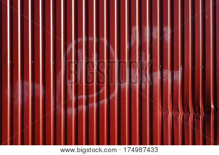 Corrugated metal sheet. Red textured background.
