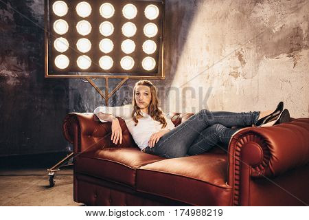 Girl Actress On The Couch In The Light Of Soffits