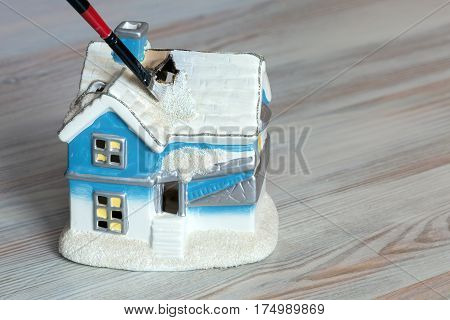 Home renovation and decoration Concept Brush painting Toy House on wooden Background