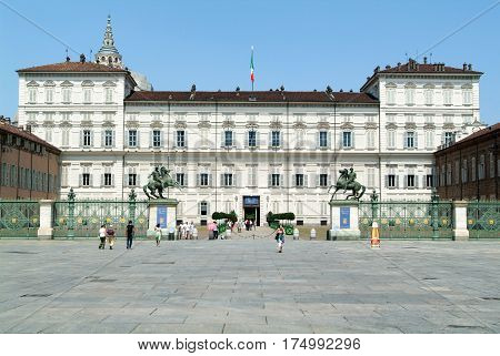 People Walking In Front Of The Royal Palace In Turin