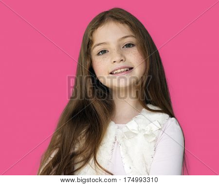 A little girl is smiling