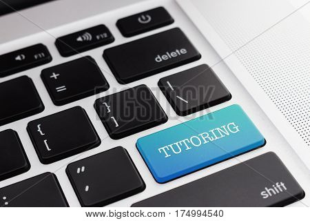 TUTORING: Close up green button keyboard computer. Digital Business and Technology Concept.