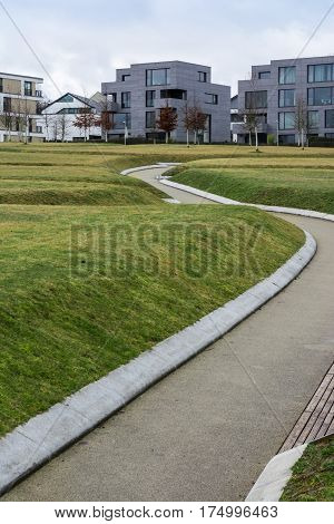 Unique Architectural Home Design Square Rectangular Geometric Angles Hard Right WIndows Alone Apartments Outdoors Park Public Store Path Leading
