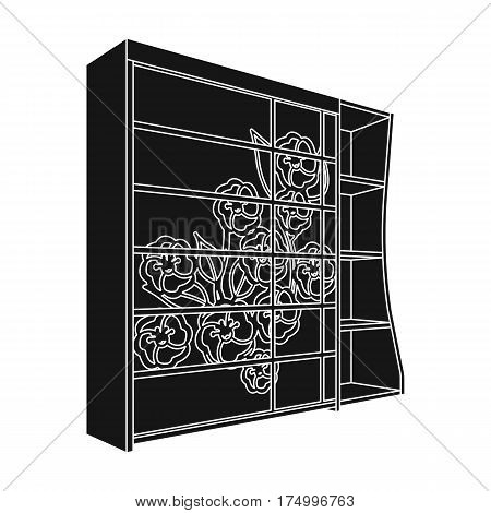 Black bedroom wardrobe with cells.Wardrobe with a beautiful rose on the door.Bedroom furniture single icon in black style vector symbol stock web illustration.